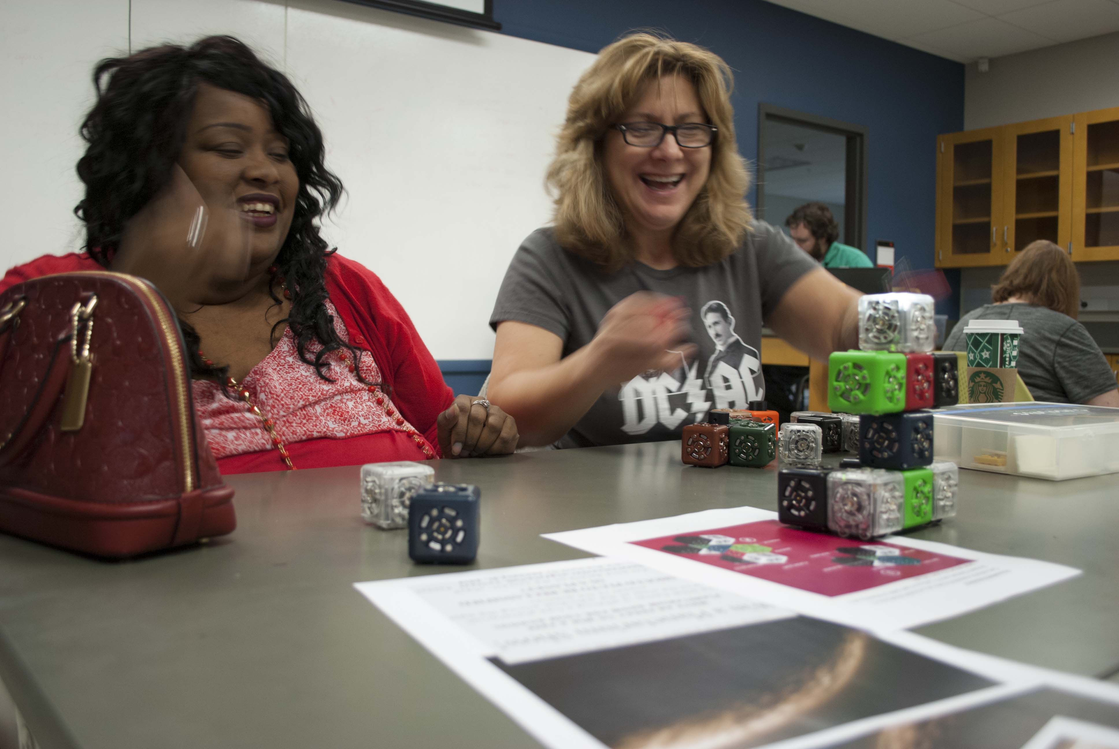 Collinsville teachers experimenting with Cubelets.
